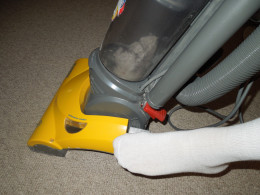 Eureka Bagless Upright Vacuum Cleaner - Tilting the Vacuum Cleaner Before Vacuuming.