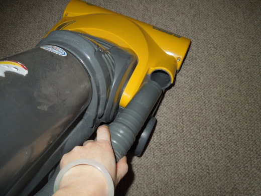 Eureka Bagless Upright Vacuum Cleaner - Connecting the Hose.