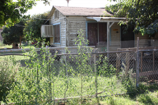 The $60 house made from a railroad boxcar lumber is still in use as of 9/14/12 ! This was the first house the Rucks family lived in Weedpatch, California.