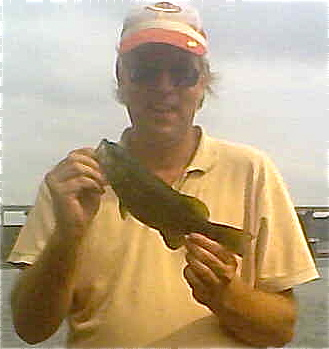 This spunky smallmouth bass jumped about three feet out of the water during its fight!
