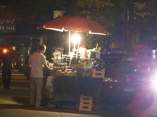 A fruit vendor doing a night shift.