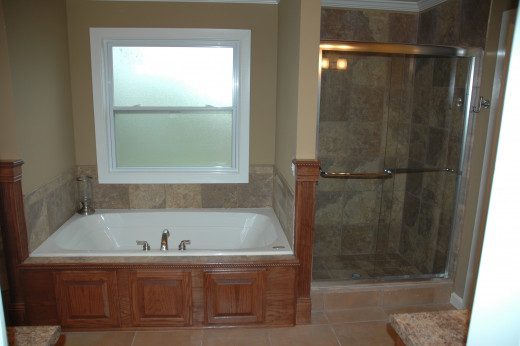 Using the same floor tiles for the shower walls and tub backsplash makes this master bath feel more spacious.
