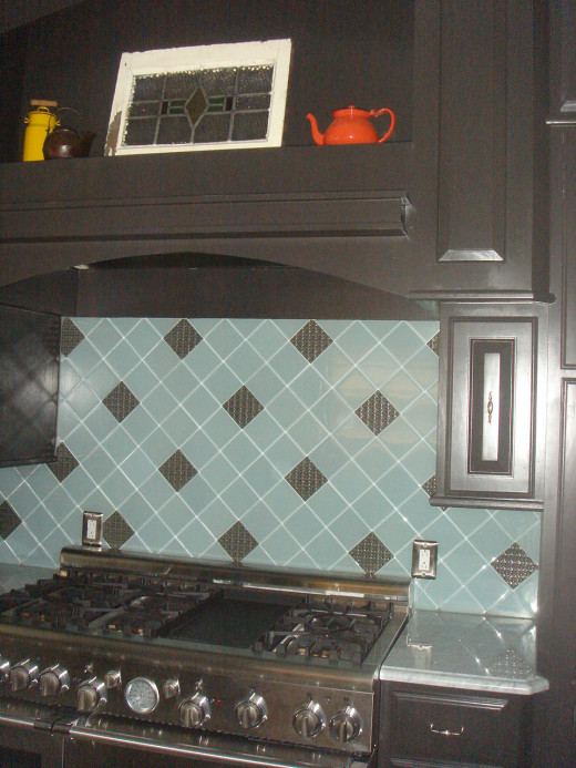 This backsplash, professional grade stove, and custom cabinetry make this area stand out in the kitchen.
