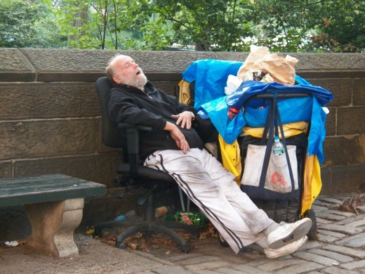 Homeless man outside Central Park.