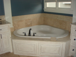 the tub backsplash incorporates the floor tile along with the shower