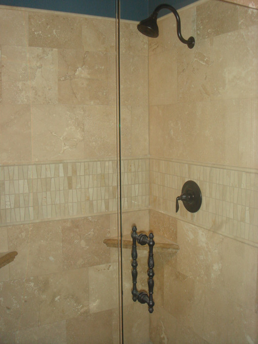 The floor tile was used for the shower walls and the tile in the stripe was used as the backsplash for the vanities.