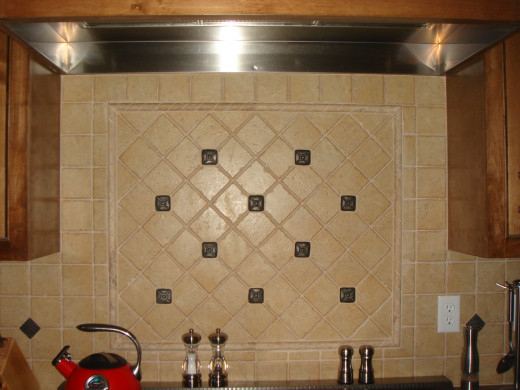 Consider using the same tile behind the stove but in a different design.