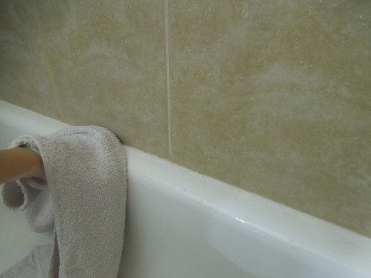 Wiping Off the Water on A Bathtub with A Towel