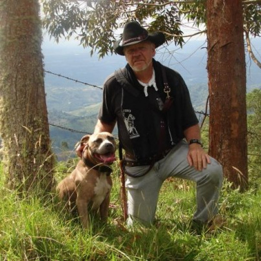 STEVE AND HIS BELOVED DOG SHARE A MOMENT ON THE SIDE OF THE ANDES