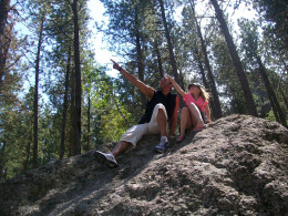My daughter and her big brother perched on a rock on our Mount Rushmore hike.