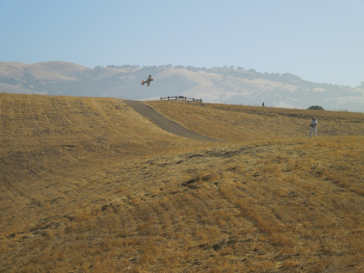 A Person is Flying A Remote Control Airplane in Montgomery Hill Park San Jose CA