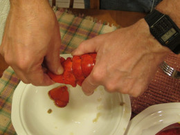 Removing the flippers from the tail of the lobster