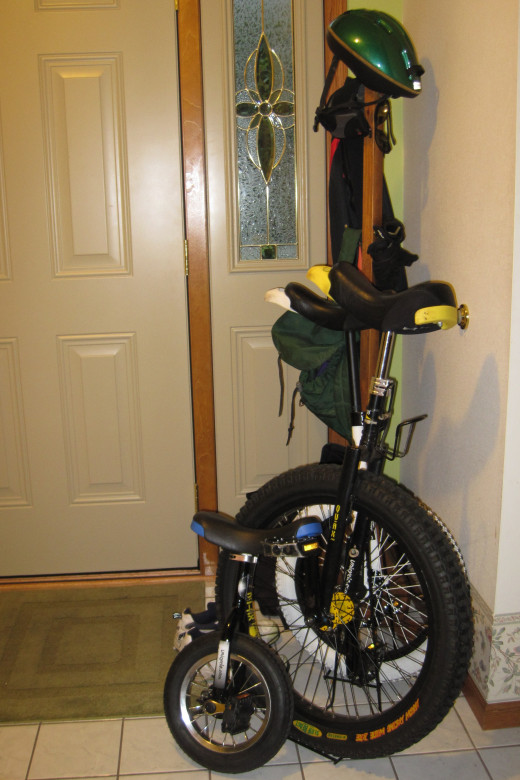 Unicycles and gear next to our front door.