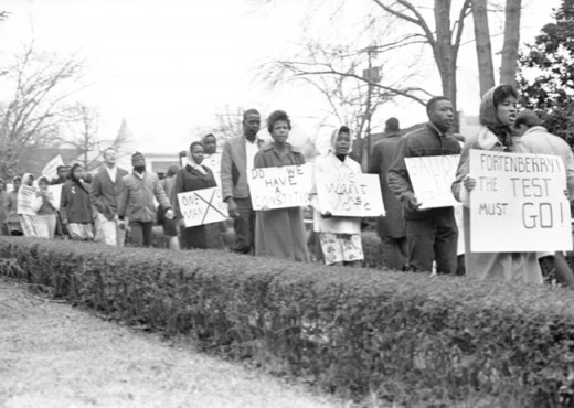 Men and women in McComb, Mississippi march in a demonstration for voting rights in 1962. (Photograph from the Johnston (Erle E., Jr.) Papers; McCain Library and Archives, University of Southern Mississippi.