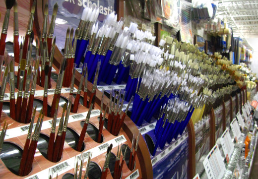 Wide selection of paint brushes on the shelves of any big art store. Photo of a brush display at Dick Blick.