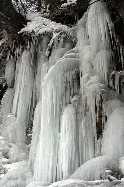 Gorgeous frozen waterfalls along the stunning Seward Highway in Alaska.