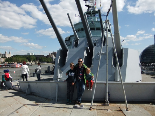 On the deck of the HMS Belfast - although you can see the guns, the photo doesn't give a true perspective of the enormity of this ship - it is huge.