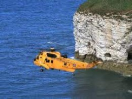 An RAF Air-Sea Rescue 'copter overflies Flamborough Head past North Landing - people often underestimate the strong current along this coast, and in places the tide rises rapidly