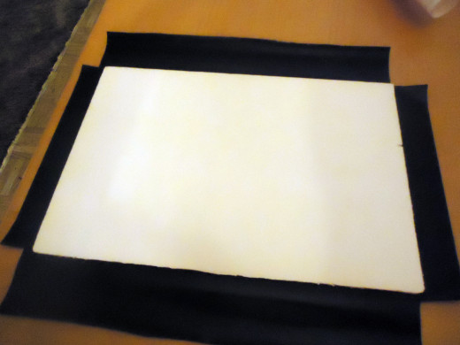 foam board on top of sticky contact paper
