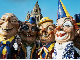 Mainz carnival - the traditional large heads - with the cathedral in the backdrop.