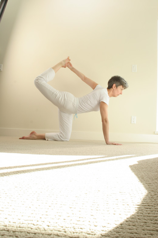 For even more challenge, bring your opposite hand and foot together, press your hand into your foot and your foot into your hand as you actively lift the raised thigh.  This deepens the work in the back, core, and thigh.