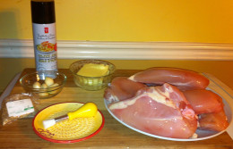 Cooking spray, lemon pepper (in the little bag), garlic cloves, butter and chicken breasts.