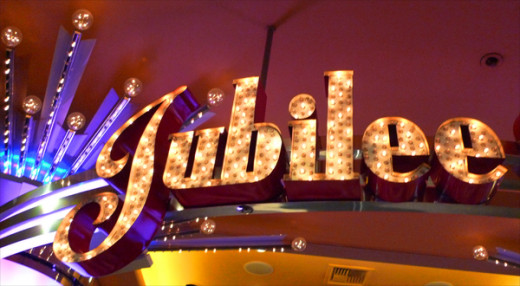 A lighted sign on the outside of the Jubilee theater, inside the Bally's Hotel.