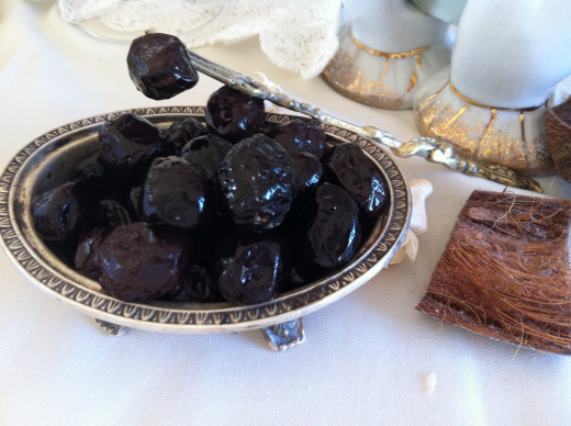 Black olives in a silver dish