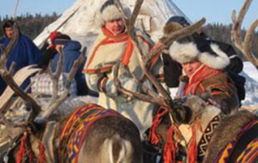 Saami people who have been deeply affected by climate change in traditional dress preparing for a cultural tradition.