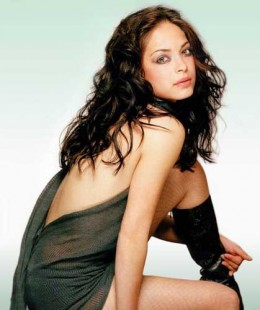 Sexy picture of Kristin Kreuk backless dress and boots