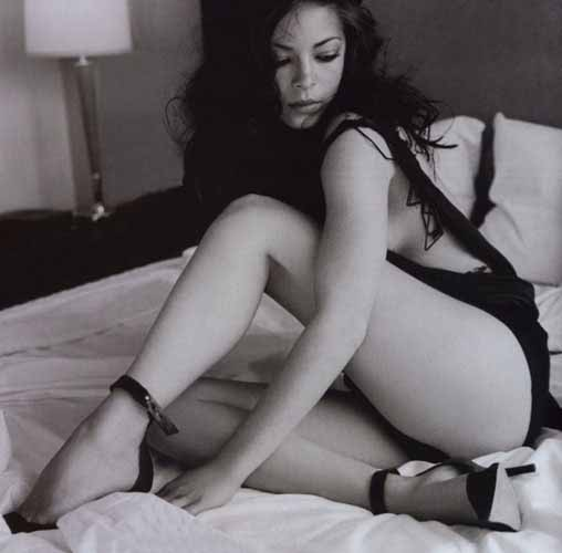 Kristin Kreuk flashing her sexy legs in this black and white picture