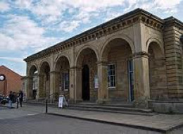 Whitby's grand station portico faces the harbour. Once the harbour reached within fifty yards of this entrance until filled in during the late 19th Century. Much of the area is taken up by a car park and supermarket where the goods shed and yard was