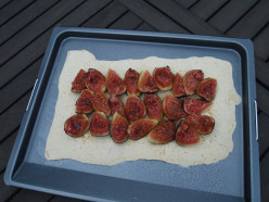 Spread the figs over the pastry, leaving a rim of about 2.5cm/1in in from all edges.