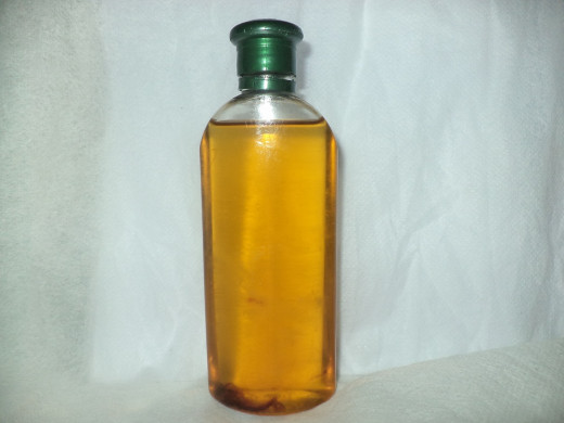 Golden yellow homemade coconut oil ready for being used as hair oil as well as for other purposes including edible oil