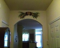Large swag installed over arched doorway.