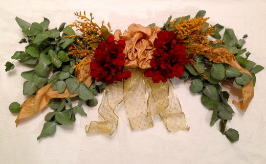 Bundling branches with ribbons and flowers is an easy way to make swags.