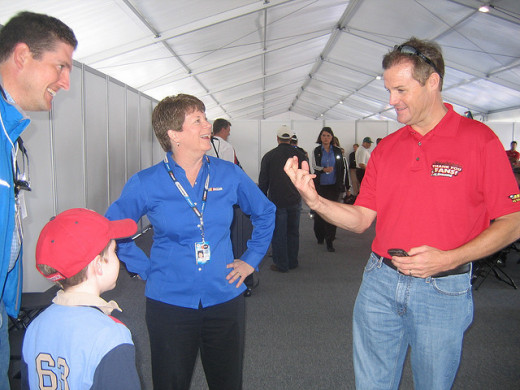 speaks with Dan Hamilton, his 8-year-old son Patrick, and Tracy Judd, Nationwide Series senior manager of communications.