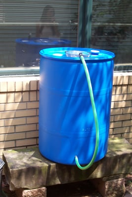 Photo of homemade rain barrel.