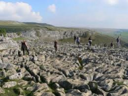 Limestone pavement above Malham Cove, the result of centuries of rain and ice breaking through the limestone capped hilltop