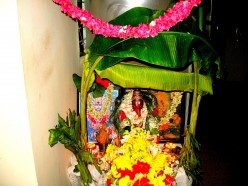 GODDESS.GOWRI DECKED WITH FLOWERS AND THE IDOL OF GANESH AFTER POOJA IN MY RESIDENCE.2012