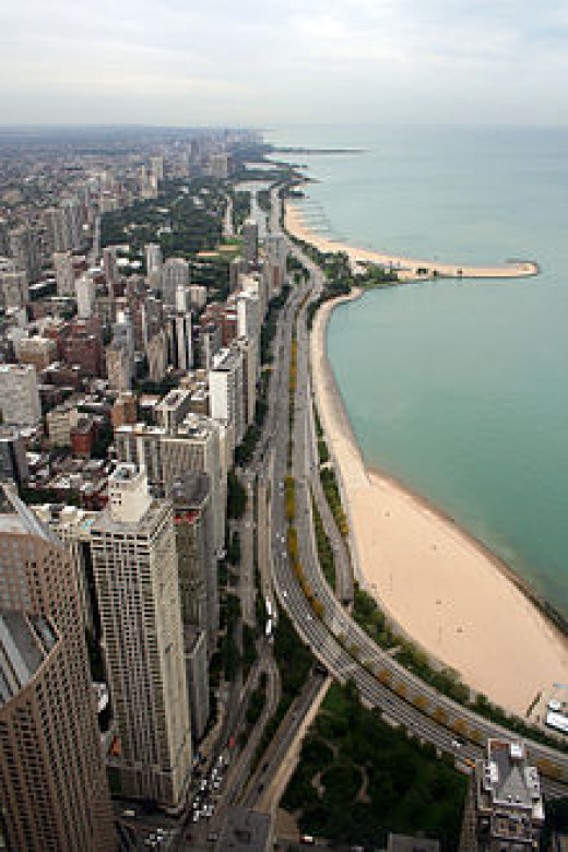 View from Hancock Tower:  Chicago Shoreline.  Upper center is Montrose Point Bird Sanctuary stretching out into Lake Michigan.