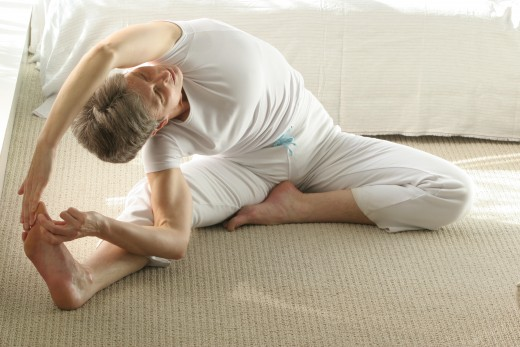 For a deeper stretch down the side, lower the top arm alongside the ear, and each time you exhale reach out into the stretch.  As your body opens, work to spiral the spine toward the inside of the straight leg.