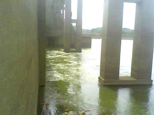 This wall view of the downriver side of Markland Dam shows the release of water churning the Ohio River close to shore.