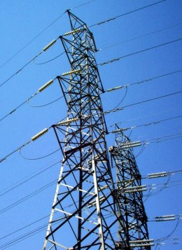 Electric power is transmitted on overhead lines like these, and also on underground high voltage cables.