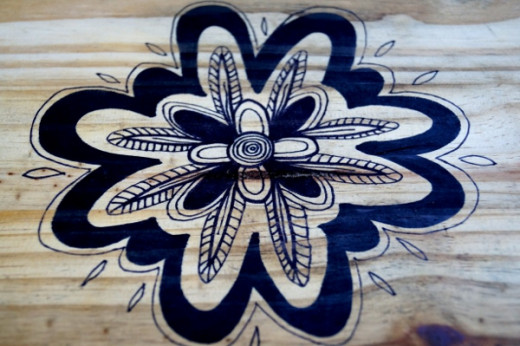 This is the abstract Sharpie flower on the bottom shelf.
