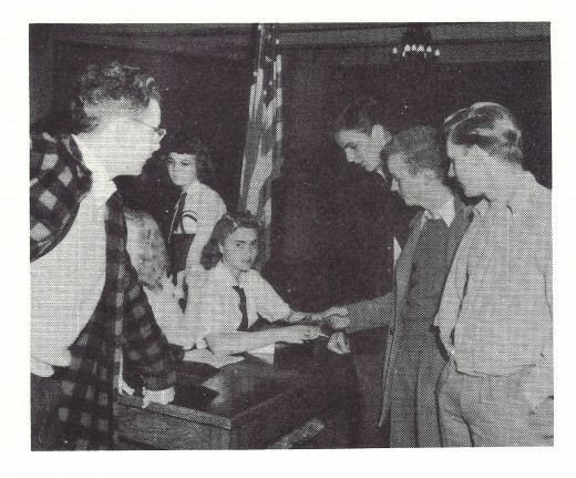From Whitefish Bay 1943 Annual - Students selling war stamps to help aid the war effort.