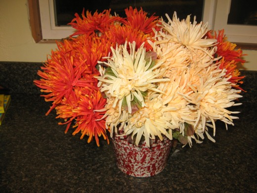 silk mums in a spatterware pail