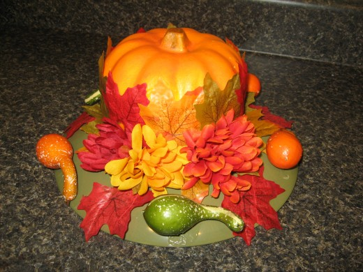 Add gourds, leaves, and mums.