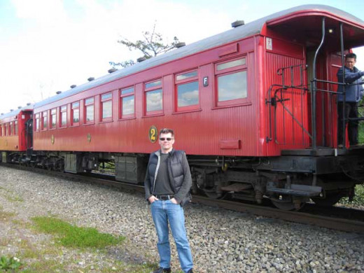 The wooden carriage probably built between 1909-12, Daffodil Express Steam train, New Zealand.