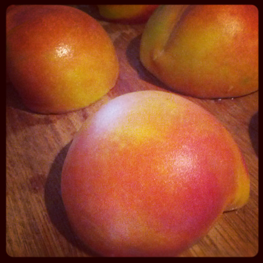 Peaches halved and pitted for grilling